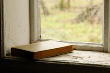 Book On An Old Window Sill In The Village