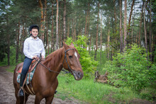 On A Sunny Summer Day In The Forest, A Boy Riding A Horse.