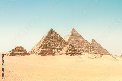 Obraz The pyramids of Giza, Cairo, Egypt. Oldest of the Seven Wonders of the Ancient World, and the only one to remain largely intact. - fototapety do salonu
