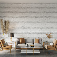Design Of Room Interior With Sofa, Armchair And Other Decor In Front Of The White Brick Wall