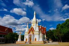 Beautiful White Buddhist Pagoda On Blue Sky With White Clouds,Wat Nong Khrok,Sisaket Province,Thailand.