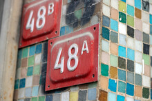 Red Colored 48 A And 48 B (forty Eight) Street Sign On The Mini Colorful Bricked Wall