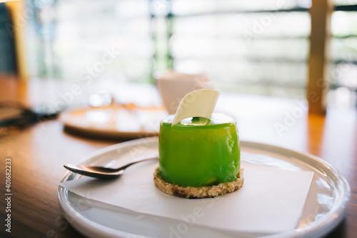 Fototapeta Delicious mousse cake on plate in cafe obraz