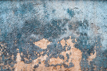 Old Cracked Weathered Painted Wall Background Texture. Light Peeled Plaster Wall With Falling Off Flakes Of Paint