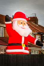 A Giant Inflatable Santa Claus In The Back Garden In A House In The North Of England