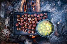 Roasting Chestnuts And Boiling Potato Stew On Open Fire With Lots Of Smoke Delicious Camper Meal Van Life Concept