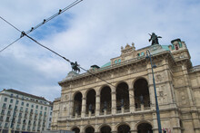 Telephone Cables In Front Of The Wiener Staatsoper (The Vienna State Opera) In Vienna, Austria. Renaissance Revival Architecture Contrasting With Contemporary Electric Urban Infrastructure