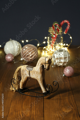 Fototapeta Christmas decoration - wooden toy rocking horse, balls for the Christmas tree, N