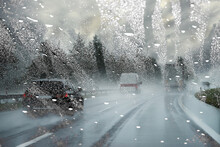 Rain-wet Windscreen Blocks The View Of The Road / Dangerous Blurry Driving Car In The Rainy Weather