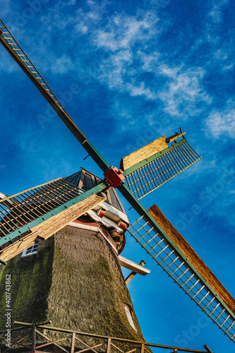Fotomural A vertical low angle shot of a windmill in Emden, German