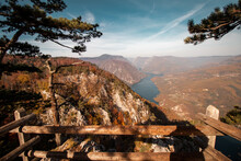 A Beautiful View From A Peak Of A Mountain Fenced With Protective Handrails