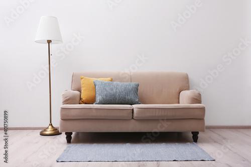 Fototapeta Simple room interior with comfortable beige sofa obraz