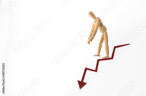 The frustrated puppet goes down the arrow tending downward Fototapeta