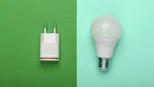 Smart Energy-saving Light Bulb With A Charger On Colored Background. Top View