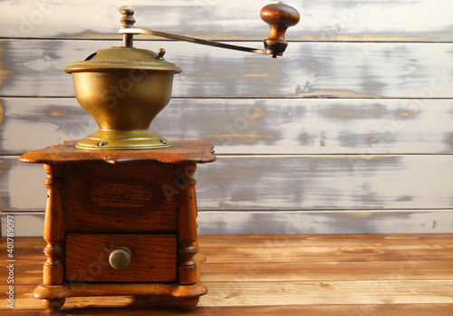 Fényképezés View on isolated old fashioned retro wooden classical coffee grinder with timber