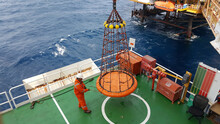 Workers Are Lifted By The Crane To The Offshore Platform, Transfer Crews By Personal Basket From The Platform To Crews Boat. Personal Basket Is Prepared By Crane For Transfer Crews.