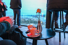 People Relaxing Having Coffee Watching The View Of Amsterdam From Rooftop