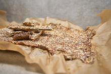 Divided Flax Seed Crackers On The Dried Not Yet Divided Tortilla.