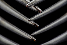 Two Crossed Metal Forks, Sharp Ends (close-up)