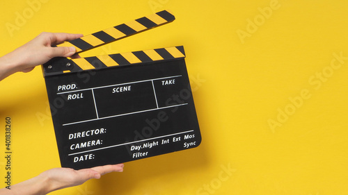 Photo Hand is holding clapper board or movie slate