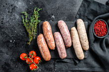 Assorted Fresh Raw Pork, Beef And Chicken Sausages With Spices.  Black Background. Top View