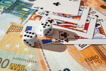 Dice, Playing Cards On A Green Cloth In A Casino Dollars And Euro Bills
