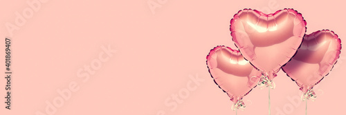 Pink air balloons heart shape on a white background. Concept wedding, valentines day, photo zone, lovers. Banner. Flat lay, top view