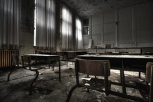 A Ruined Classroom With Broken Desks And Walls Of An Abandoned School