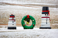 Snowmen And A Wreath Made Out Of Recycled Tires For Christmas Decorations