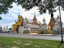 Big Buddha Statue With Stupa At Wat Nong Pong Nok, Temple. Nakhon Pathom Province, Thailand.