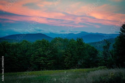 The sun sets over the Adirondack Mountains near Saranac Lake, New York