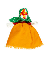 Traditional Russian Fabric Doll. A Doll In An Orange Dress And A Green Scarf. Home Amulet And Children's Toy.