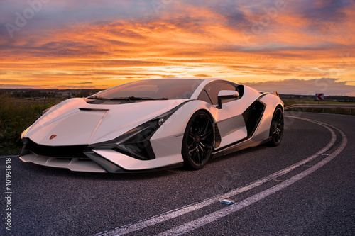 Lamborghini Sian FKP 37 on the road during a spectacular sunset