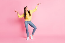 Full Size Photo Of Young Beautiful Cute Charming Smiling Girl Look At Hands Dance Isolated On Pink Color Background