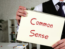 Business Concept Meaning Common Sense With Sign On The Piece Of Paper.