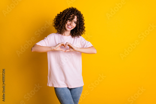 Photo portrait of flirty girlfriend with curly hairstyle showing love symbol hea Wallpaper Mural
