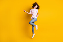 Photo Portrait Full Body View Of Girl Jumping Up Playing On Imaginary Guitar Isolated On Vivid Yellow Colored Background