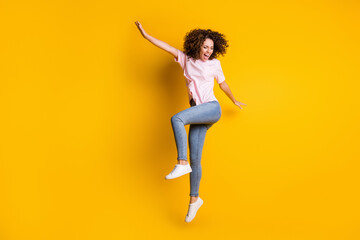 Fototapeta Koszykówka Photo portrait full body view of happy girl dancing jumping up isolated on vivid yellow colored background