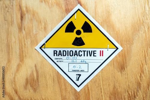 Radiation label beside the transport wooden box Type A package Fototapeta