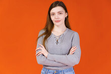 Portrait Of A Young Girl Isolated On Orange Background