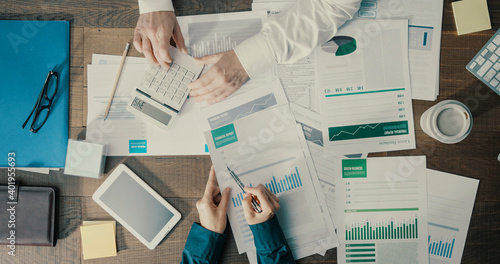 Fototapeta Business people checking financial charts together obraz
