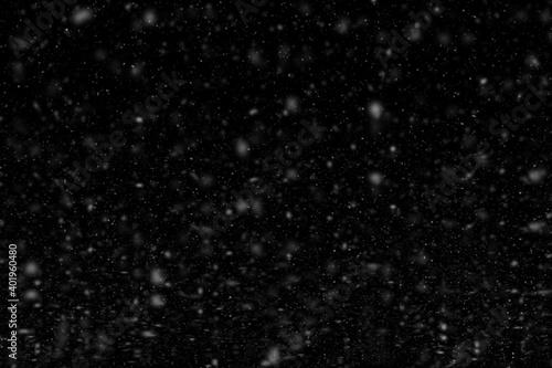 Foto Falling snowflakes on black background