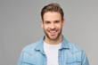Portrait of young handsome caucasian man in jeans shirt over light background