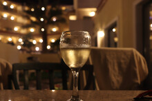 Wine Glass At Night Scattering Light From Nearby Lamps