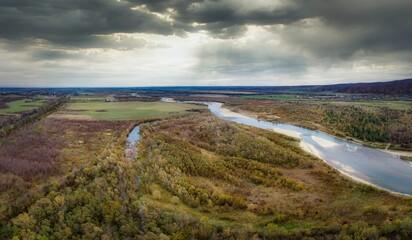 Flight over autumn mountain river