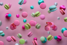 Levitation Of Macaroons, Creative Food Concept. Bold Vibrant Pink, Mint Green, Mint Blue And Magenta Colors. Flying Macaroons, Disco Balls And Decorative Metallic Balls On Pink Paper Background.