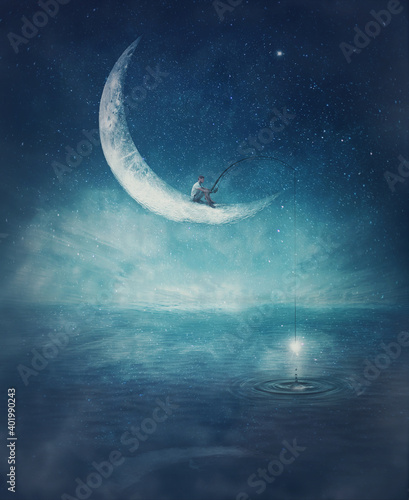 Obraz Surreal scene with a boy fishing for stars, seated on a crescent moon with a rod in his hands. Magical adventure concept. Wonderful starry night sky reflecting over the clear blue ocean water. - fototapety do salonu