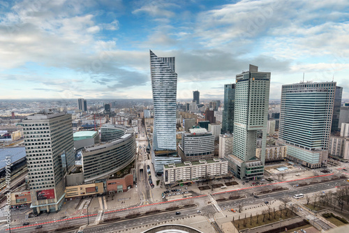 Obraz WARSAW, POLAND. Aerial view with Zlote tarasy, Zlota 44 skyscraper, Warsaw Towers, InterContinental Hotel, Warsaw Financial Center - skyscrapers panorama from The Palace of Culture - fototapety do salonu