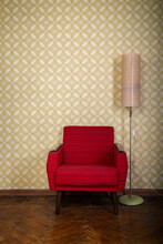 Vintage Room With Old Fashioned Armchair, Standart Lamp, Old Fashioned Wallpaper And Weathered Wooden Parquet Floor