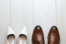 Wedding Shoes On White Wooden Floor, Flat Lay. Space For Text